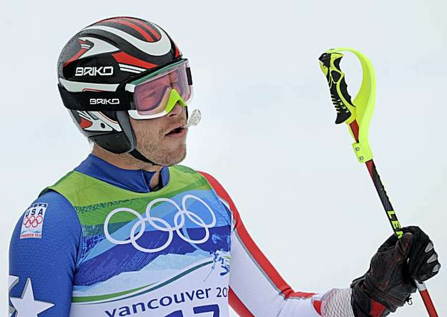 Bode Miller of the United States skis into the finish area after skiing out during the first run of the Men's slalom, at the Vancouver 2010 Olympics in Whistler, British Columbia, Saturday, Feb. 27, 2010. Photo: Gero Breloer, AP