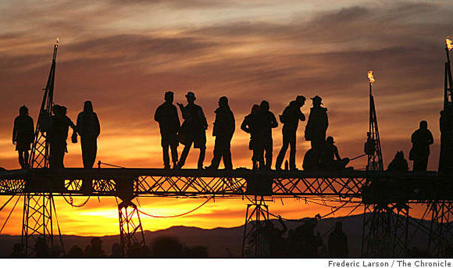 Burning Man participants watch the sun rise on the playa at Black Rock, Nevada on August 27, 2008. Photo: Frederic Larson, The Chronicle
