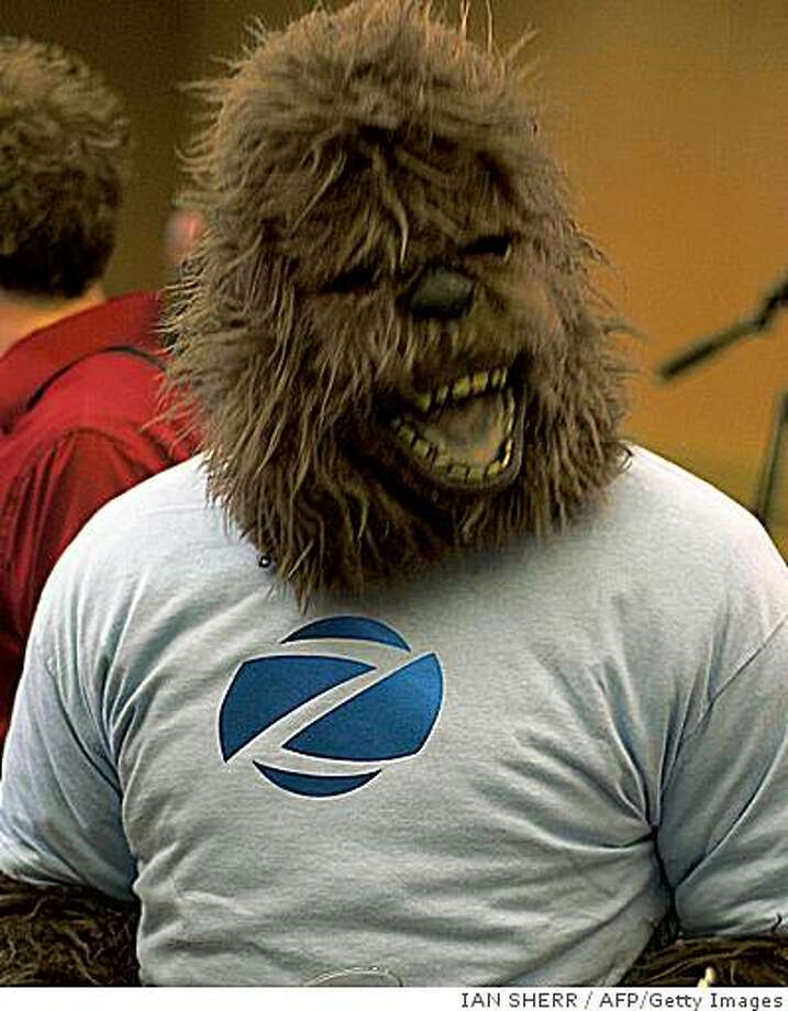 """A man in a gorilla suit mocks the proceedings of a press conference on August 15, 2008 in Palto Alto, California, when pictures were presented purporting to be the body of """"Bigfoot,"""" the legendary ape-like creature that has been the subject of decades of hoaxes and dubious sightings. The body, purportedly discovered in a northern part of the US state of Georgia in June 2007, was said to be seven-feet, seven-inches tall and weigh more than 500 pounds.  Bigfoot, also referred to as """"Sasquatch,"""" tells of a gargantuan, elusive furred creature that walks upright and lives in remote forests in the Pacific Northwest of the United States and Canada. Georgia is in the country's south.  Many scientists believe Bigfoot is folklore instead of fact.     AFP PHOTO /  Ian SHERR (Photo credit should read Ian Sherr/AFP/Getty Images) Photo: IAN SHERR, AFP/Getty Images"""