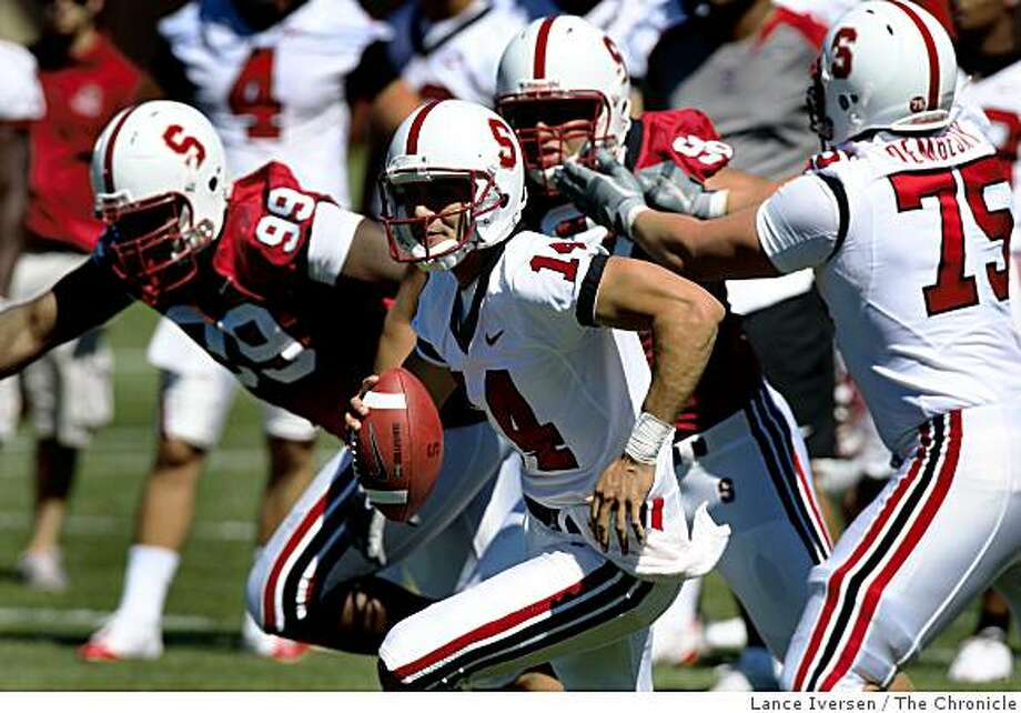 Stanford's Tavita Pritchard scrambles outside of the pocket under pass pressure from his own defense during the team's football training camp in Palo Alto on Saturday, August 2, 2008. Photo by Lance Iversen / The Chronicle Photo: Lance Iversen, The Chronicle