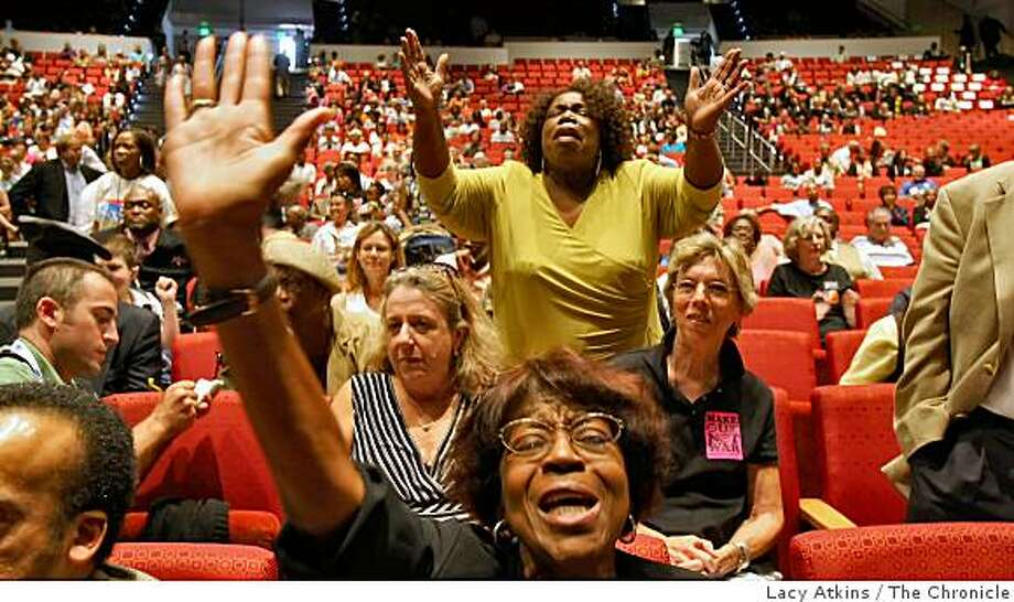 Helen Lee, front and Claudette Sweet, both Baptist sing out in prayer during the Faith in Action Interfaith Gathering, Sunday Aug. 24, 2008, put on by the Democratic National Convention Committee, in Denver, Colorado. Photo: Lacy Atkins, The Chronicle