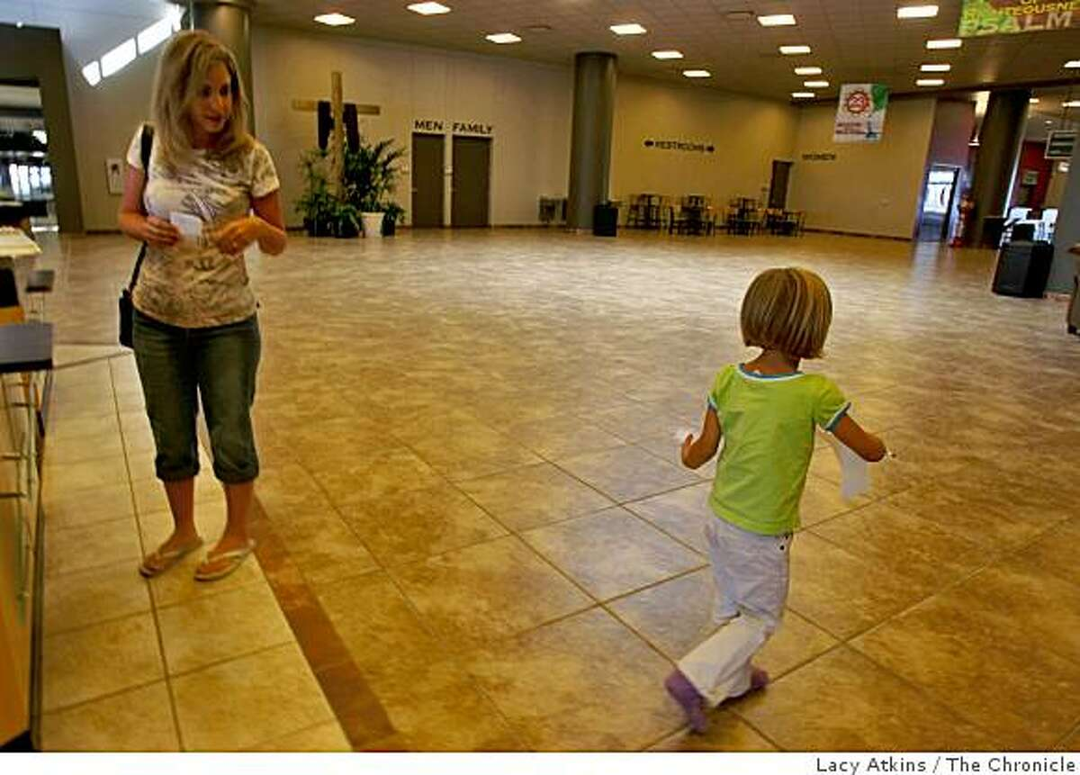 Genee White, 35 years old sends her daughter Fayth, off with drawing paper as she starts to look for work in the directory at the New Life Church, Friday Aug. 22, 2008, in Colorado Springs, Colorado.