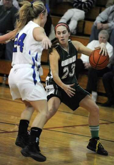 Dani DeGregory of Greenwich is guarded by Rachel Moore of Hoosic Valley during a basketball game on