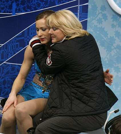 Joannie Rochette of Canada and her coach Manon Perron embrace after Rochette's bronze medal-winning performance in the free program of the women's figure skating competition at the Winter Olympic Games in Vancouver, British Columbia, on Thursday, Feb. 25, 2010. Paul Chinn/Chronicle Olympic Bureau Photo: Paul Chinn, The Chronicle