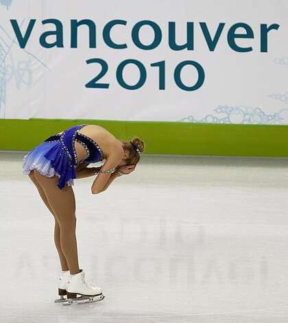 Carolina Kostner of Italy reacts after falling four times in her free program of the women's figure skating competition at the Winter Olympic Games in Vancouver, British Columbia, on Thursday, Feb. 25, 2010. Paul Chinn/Chronicle Olympic Bureau Photo: Paul Chinn, The Chronicle
