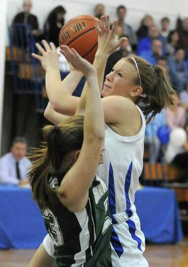 Hoosic Valley's Alicia Lewis is guarded by Dani DeGregory of Greenwich as she drives to the basket d