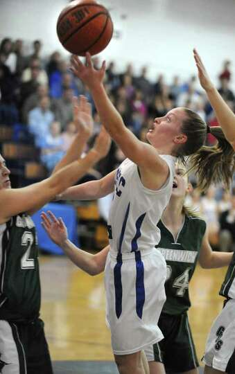 Hoosic Valley guard Cassidy Chapko drives to the basket during a basketball game against Greenwich o