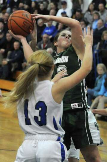Anissa Anuszewski of Greenwich drives to the basket against Sam Connors of Hoosic Valley during a ba