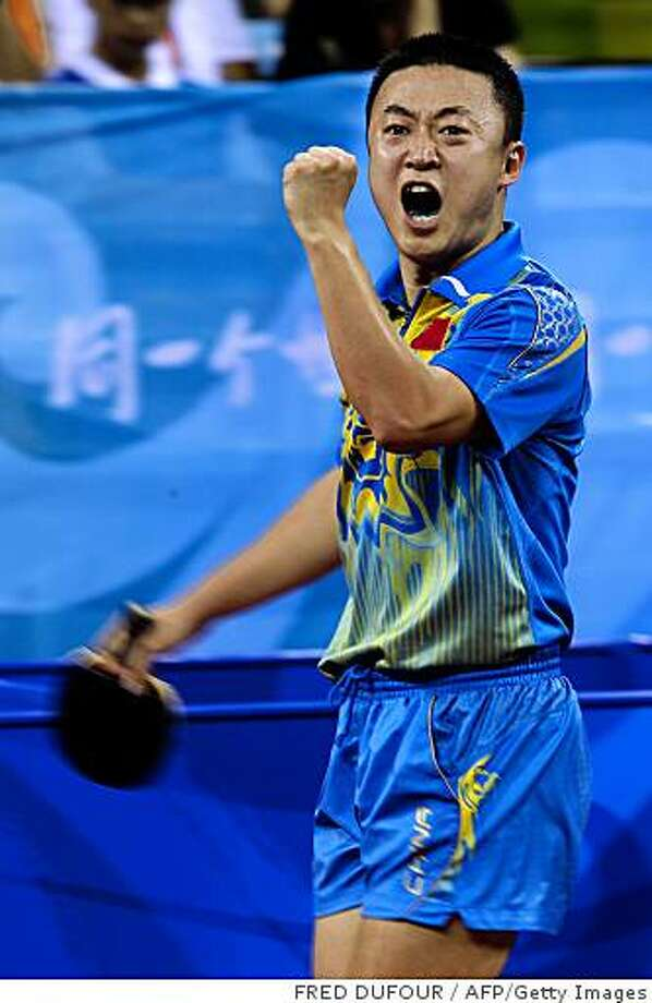 Ma Lin of China jubilates after scoring a point against compatriot Wang Ligin in their men's table tennis singles semifinals match at the 2008 Beijing Olympic Games on August 23, 2008.  AFP PHOTO / FRED DUFOUR (Photo credit should read FRED DUFOUR/AFP/Getty Images) Photo: FRED DUFOUR, AFP/Getty Images