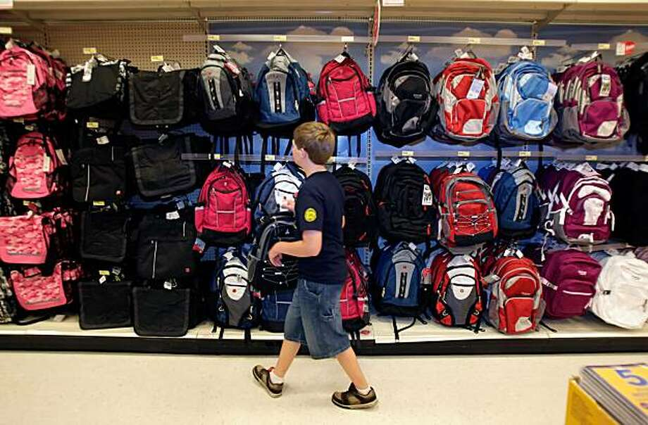 Jacob Hanawalt, 12, looks for a backpack for school at the Target in Berkeley, Calif., on Thursday, August 21, 2008. Back-to-school shopping feature. With the middle class reeling from high food and gas prices, small wage gains and falling home values, how are families handling the annual school-shopping ritual? Are they taking special steps to economize? Photo: Carlos Avila Gonzalez, The Chronicle
