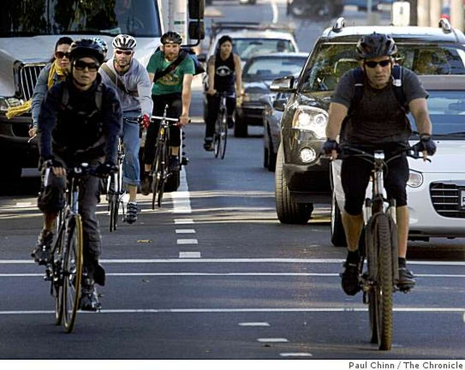 Bicyclists ride toward downtown on Market Street in San Francisco, Calif., on Friday, Aug. 22, 2008. Higher gas prices are luring more commuters out of their cars and onto their two-wheelers. Photo: Paul Chinn, The Chronicle