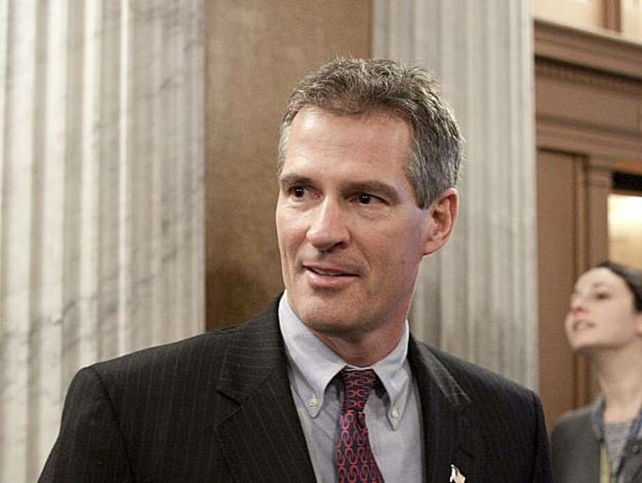 Sen. Scott Brown, R-Mass., talks to reporters after he voted for cloture on the Jobs Bill on Capitol Hill in Washington, Monday, Feb. 22, 2010. A bipartisan jobs bill cleared a GOP filibuster with critical momentum provided by the Senate's newest Republican. Photo: Harry Hamburg, AP