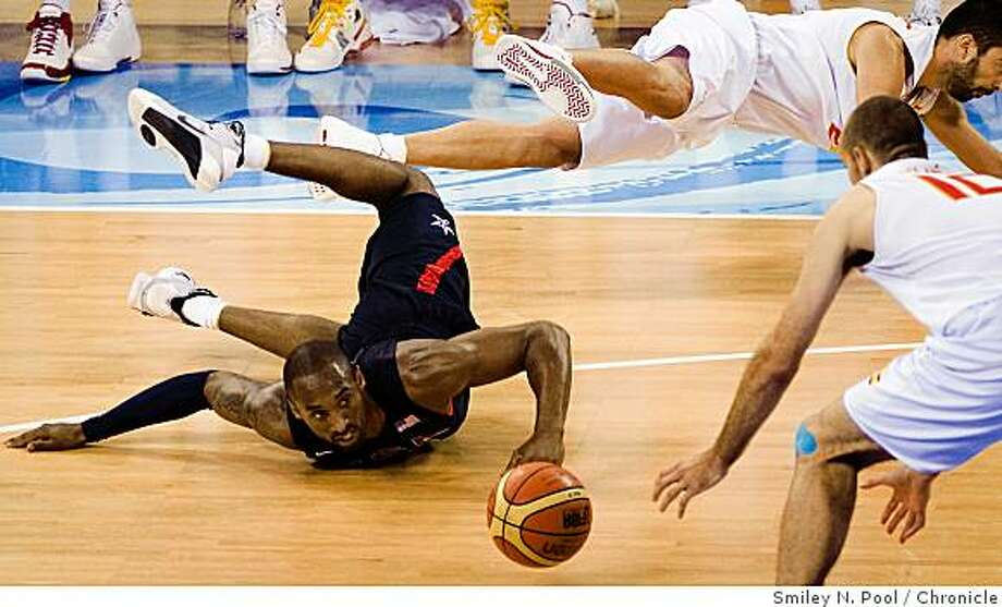 Kobe Bryant of the USA slides on the floor chasing a loose ball during first half action of the gold medal final against Spain in men's basketball at the 2008 Summer Olympic Games, Sunday, Aug. 24, 2008, in Beijing. The USA defeated Spain to win the gold. ( Smiley N. Pool / Chronicle ) Photo: Smiley N. Pool, Chronicle