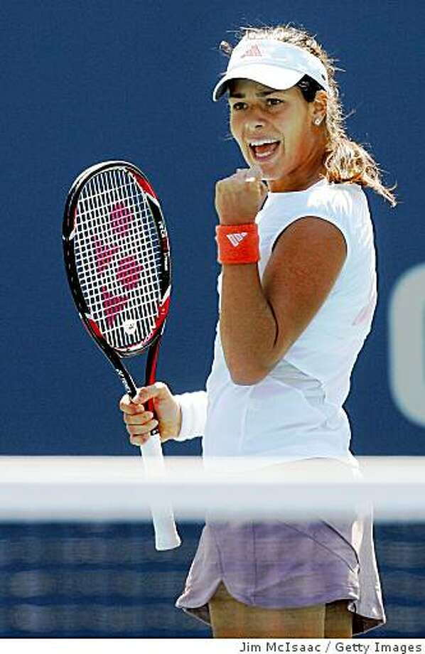 NEW YORK - AUGUST 26:  Ana Ivanovic of Serbia reacts after a point against Vera Dushevina of Russia during Day 2 of the 2008 U.S. Open at the USTA Billie Jean King National Tennis Center on August 26, 2008 in the Flushing neighborhood of the Queens borough of New York City. Ivanovic defeats Dushevina 6-1 4-6 6-4.  (Photo by Jim McIsaac/Getty Images) Photo: Getty Images
