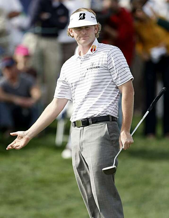 Brandt Snedeker watches his putt for birdie stop shy of the cup on the 18th green during the third round of the Phoenix Open PGA golf tournament Saturday, Feb. 27, 2010, in Scottsdale, Ariz. Photo: Paul Connors, AP