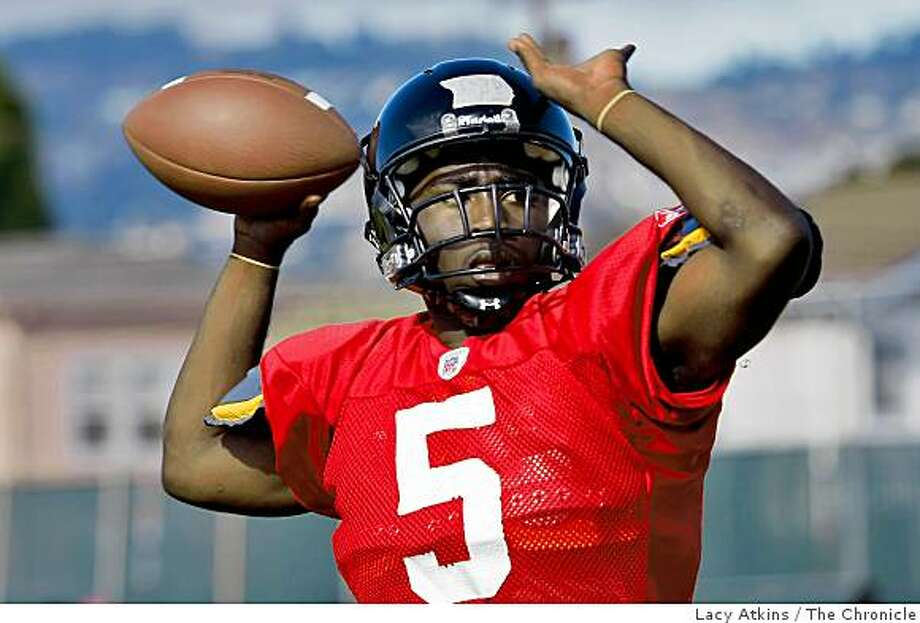 Robert Bringham, quarterback with the McClymonds High School Football team practices, Tuesday Aug. 19, 2008, in Oakland, Calif. Photo: Lacy Atkins, The Chronicle