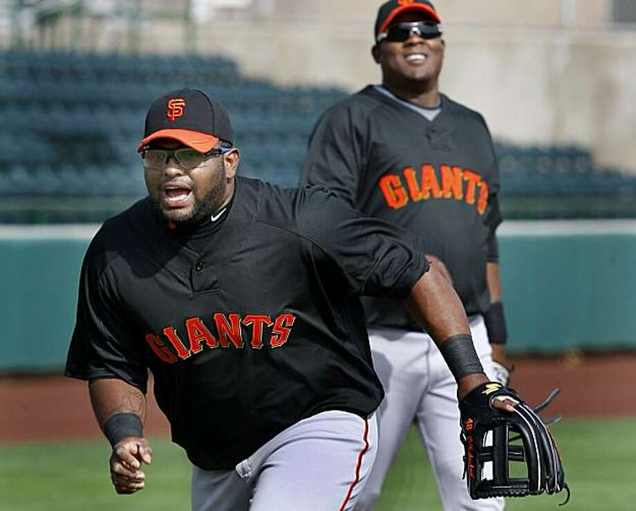 Pablo Sandoval in a workout with Juan Uribe in the background. Annual spring training action with the Giants and Athletics from Scottsdale and Phoenix, Arizona. Photo: Brant Ward, The Chronicle