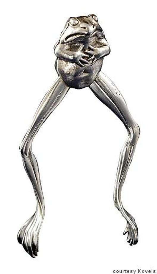 This strange, leggy frog is a pair of silver sugar tongs. It sold at a recent auction for $1,016. Photo: Courtesy Kovels