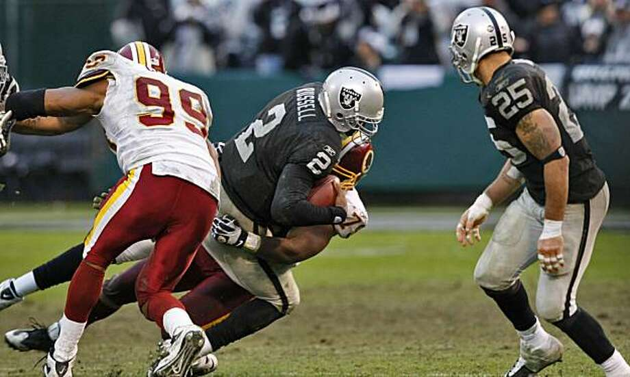 Raiders quarterback JaMarcus Russell is sacked in the second half against the Redskins on Sunday in Oakland. Photo: Lacy Atkins, The Chronicle