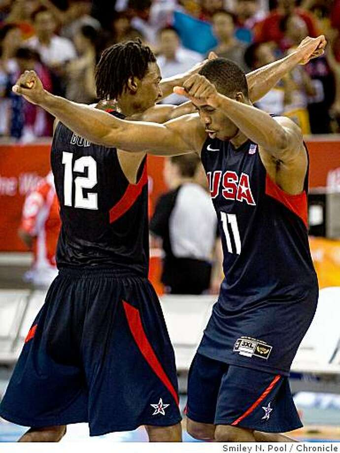Dwight Howard (11) and Chris Bosh (12) celebrate after the USA defeated Argentina 101-81 to advance to the gold medal game in men's basketball at the 2008 Summer Olympic Games, Saturday, Aug. 23, 2008, in Beijing. Photo: Smiley N. Pool, Chronicle