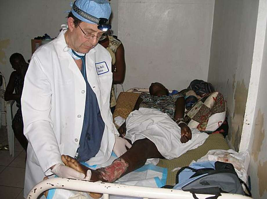 Dr. Claude Roge treats a victim of the Jan. 12 Haiti earthquake. Photo: Courtesy, Claude Roge
