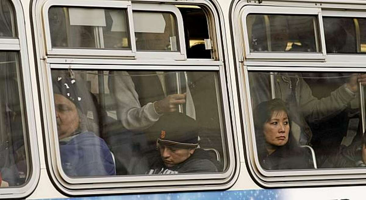 MUNI riders aboard a bus near the corner of Fillmore and Geary Streets in the San Francisco, Calif on Thursday January 28, 2010. With the Municipal Transportation Agency facing a $53 million budget deficit next year, they are considering the following recommendations: reduce the frequency of bus and rail service on most routes, equivalent to a 10 percent cut systemwide; charge Fast Pass users a premium for using express buses or cable cars; double the cost of discounted monthly passes for seniors, youth and the disabled to $30.