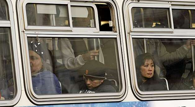 MUNI riders aboard a bus near the corner of Fillmore and Geary Streets in the San Francisco, Calif on Thursday January 28, 2010. With the Municipal Transportation Agency facing a $53 million budget deficit next year, they are considering the following recommendations: reduce the frequency of bus and rail service on most routes, equivalent to a 10 percent cut systemwide; charge Fast Pass users a premium for using express buses or cable cars; double the cost of discounted monthly passes for seniors, youth and the disabled to $30. Photo: Michael Macor, The Chronicle
