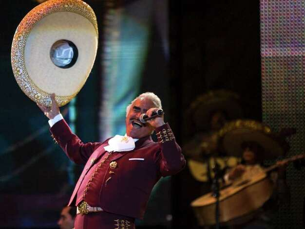 Mexican singer Vicente Fernandez performs at a free concert during Valentine's Day in Mexico City's Zocalo, Saturday Feb. 14, 2009. Thousands gathered in Mexico City's central plaza to pucker up for peace and break the world record for the largest number of people kissing at one time. (AP Photo/Claudio Cruz) Photo: Claudio Cruz, ASSOCIATED PRESS / AP2009
