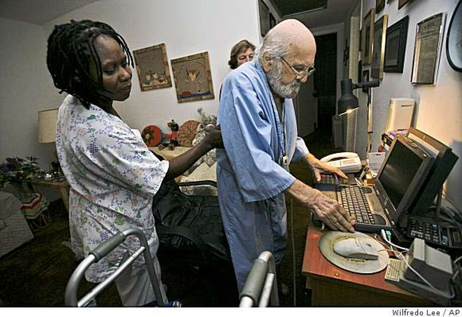 **APN ADVANCE FOR SUNDAY AUG. 24**Nurse's aide Anelia Santfleur, left, helps Martin Hornung, 86, sit down at the computer  Monday, Aug. 4, 2008 at Hornung's home in Century Village in Boca Raton, Fla. Hornung, like many survivors, is haunted by memories of the Holocaust. Because nursing homes, with strangers in uniforms, desolate shower rooms and medical procedures can exacerbate flashbacks even more, Jewish organizations are trying to care for survivors at home to make their final years as comfortable as possible. (AP Photo/Wilfredo Lee) Photo: Wilfredo Lee, AP