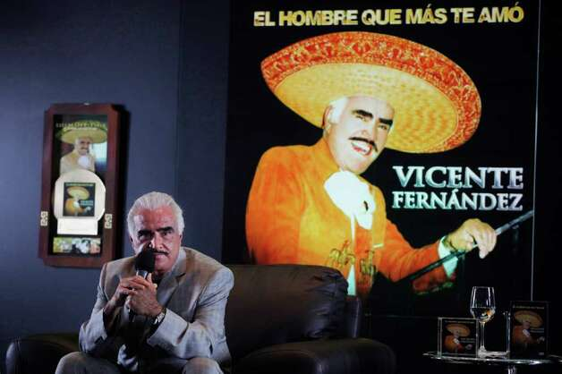 "Mexico's singer Vicente Fernandez listens to questions during a press conference to present his new album: ""El hombre que más te amó"", or ""The man who loved you most"" in Mexico City, Thursday, Oct. 28, 2010. (AP Photo/Alexandre Meneghini) Photo: Alexandre Meneghini, ASSOCIATED PRESS / AP2010"