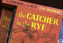 """Copies of J.D. Salinger's classic novel """"The Catcher in the Rye"""" are seen at the Orange Public Library in Orange Village, Ohio on Wednesday, Jan. 28, 2010.  Salinger, the legendary author, youth hero and fugitive from fame whose """"The Catcher in the Rye"""" shocked and inspired a world he increasingly shunned,  died Wednesday at the age of  91."""