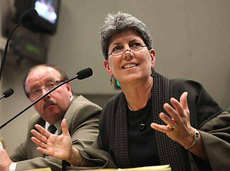 Leslie Margolin, president of Anthem Blue Cross, answers a question concerning premium rates hikes with while appearing befoe the Assembly Health Committee at the Capitol in Sacramento, Calif., Tuesday, Feb. 23, 2010.  Executives of Anthem Blue Cross, California's largest for-Profit health insurer,  appeared before the committee to explain an attempt to boost insurance premiums by up to 39 percent.  At left if anthem vice president and general manager James Oatman. Photo: Rich Pedroncelli, AP