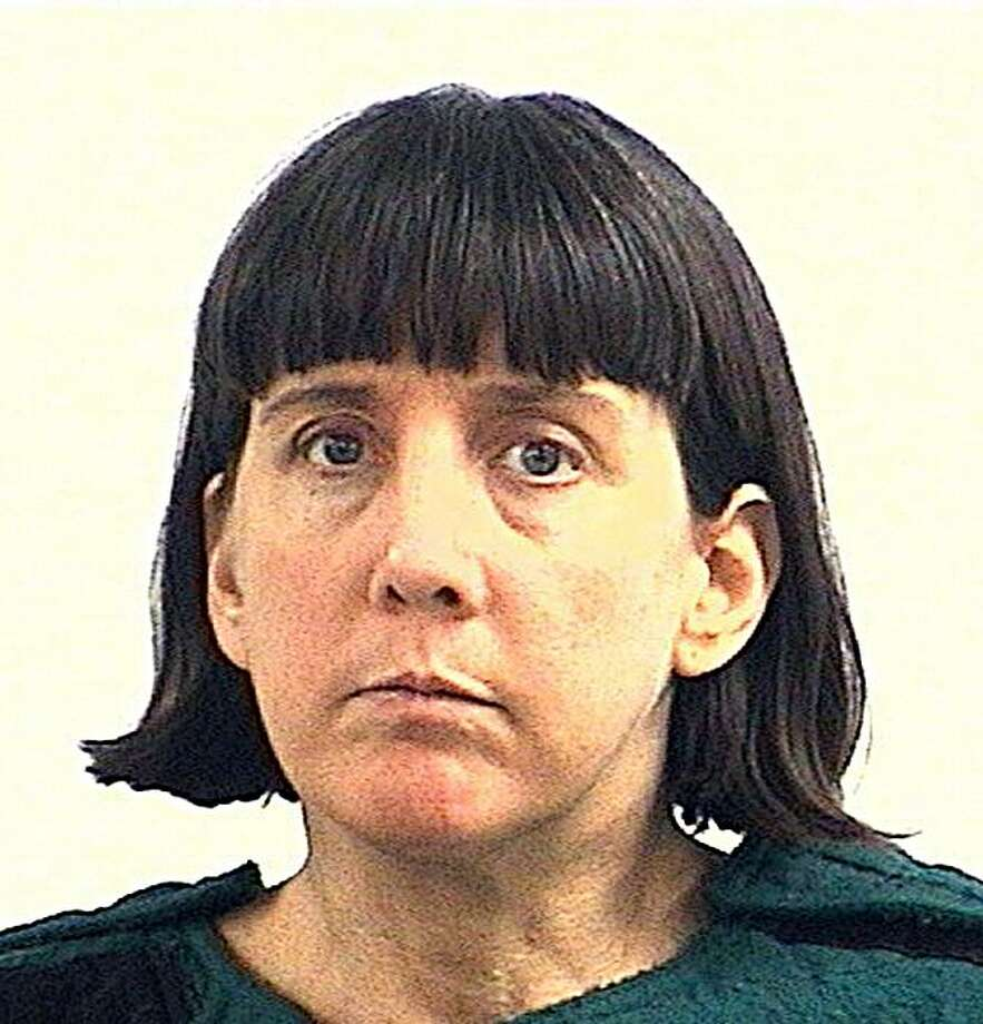 This police mugshot obtained from the Huntsville, Alabama, Police Department shows shooting suspect Amy Bishop. The biology professor is facing murder charges after three staff members were killed and three injured in a shooting spree at Alabama University on February 12, 2010. Bishop was arrested outside the Shelby Center building where the shooting happened. Photo: -, AFP/Getty Images