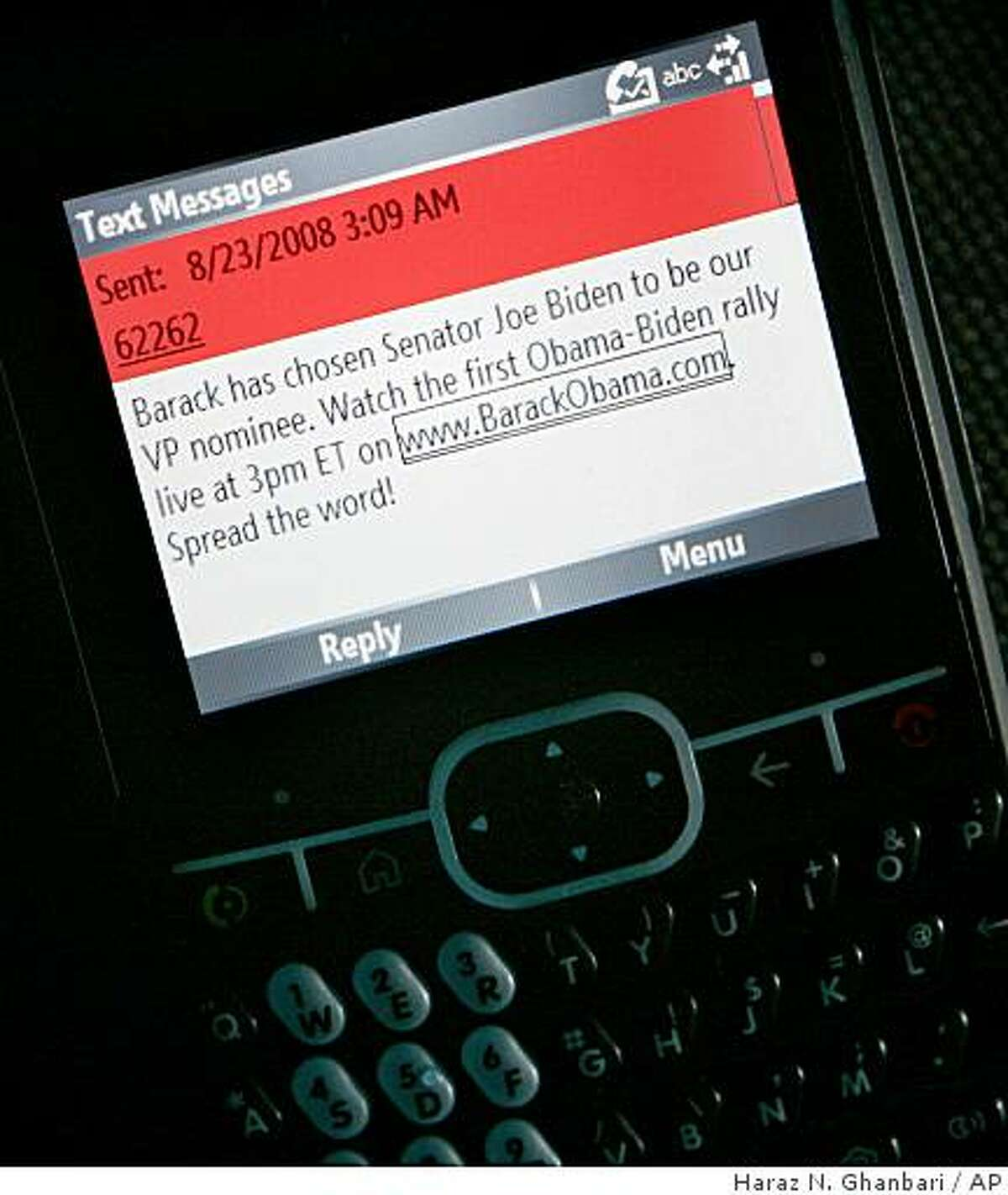 """The text message announcing the choice of Sen. Joe Biden of Delaware as the vice presidential selection for the Democratic party is seen on a communication device, Saturday, Aug. 23, 2008, in Greenville, Del., after it arrived at 3:09 AM. Obama announced the pick on his Web site with a photo of the two men and an appeal for donations. A text message went out shortly afterward that said, """"Barack has chosen Senator Joe Biden to be our VP nominee."""" (AP Photo/Haraz N. Ghanbari)"""
