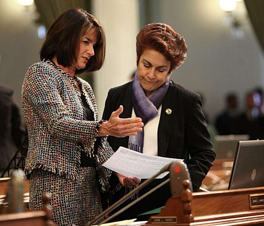 Assemblywoman Diane Harkey, R-Dana Point left, and Assemblywoman Anna Caballero, D-Salinas, look over information on the California's structural budget deficit at the Capitol in Sacramento, Calif., Monday, Feb. 22,  2010.  Lawmakers in both houses are expected to vote on a Democratic package of bills designed to reduce California's $20 billion budget deficit by $5 billion. Photo: Rich Pedroncelli, AP