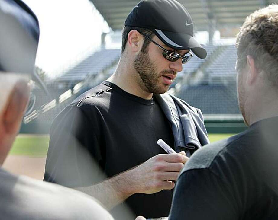 Minnesota Twins Joe Mauer signs an autograph at baseball spring training, in Fort Myers, Fla., Sunday, Feb. 21, 2010. Photo: Nati Harnik, AP