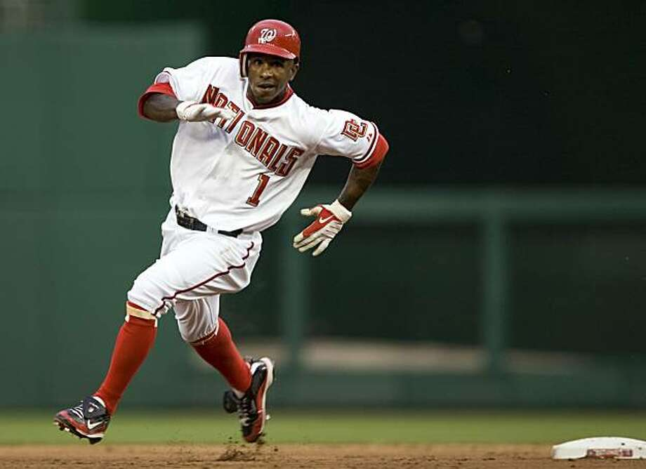 Washington Nationals' Nyjer Morgan rounds second base after hitting a triple against the San Diego Padres in the first inning of a baseball game on Saturday, July 25, 2009, in Washington.  (AP Photo/Evan Vucci) Photo: Evan Vucci, AP