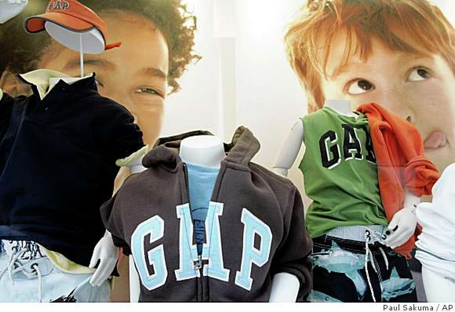 To get people past that thinking, retailers are going beyond any usual price cuts. Gap Inc. is expanding its ?friends and family? discount program. Gap Kids clothes on display at a Gap Kids store in Palo Alto, Calif., Wednesday, May 21, 2008.  Gap Inc. is expected to release quarterly earnings after the closing bell Thursday.  (AP Photo/Paul Sakuma) Photo: Paul Sakuma, AP