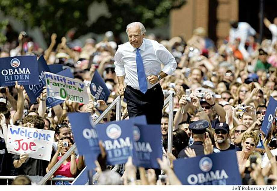 Democratic vice presidential running mate Sen. Joe Biden, D-Del., jogs out to meet Democratic presidential candidate Sen. Barack Obama, D-Ill., as they appear together outside the Old State Capitol Saturday, Aug. 23, 2008, in Springfield, Ill. (AP Photo/Jeff Roberson) Photo: Jeff Roberson, AP