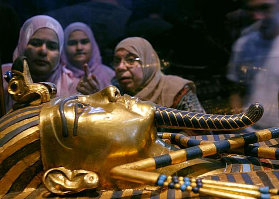 Women look at one of the coffins of King Tutankhamun at the Egyptian museum in Cairo, Egypt. Photo: Amr Nabil, AP