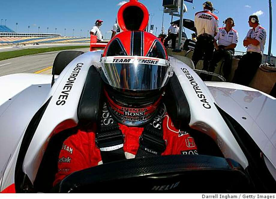SPARTA, KY - AUGUST 08: Helio Castroneves sits aboard the #3 Team Penske Dallara Honda during practice for the IndyCar Series Meijer Indy 300 on August 8, 2008 at the Kentucky Speedway in Sparta, Kentucky.  (Photo by Darrell Ingham/Getty Images) Photo: Getty Images