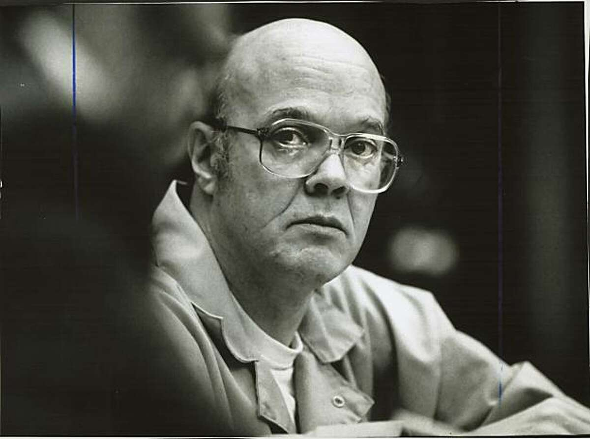 Trailside killer David Joseph Carpenter watched his lawyers during the first day of his Marin County trial. Carpenter was dressed in an orange jumpsuit and took notes constantly. Photo was taken: 09/04/1985.