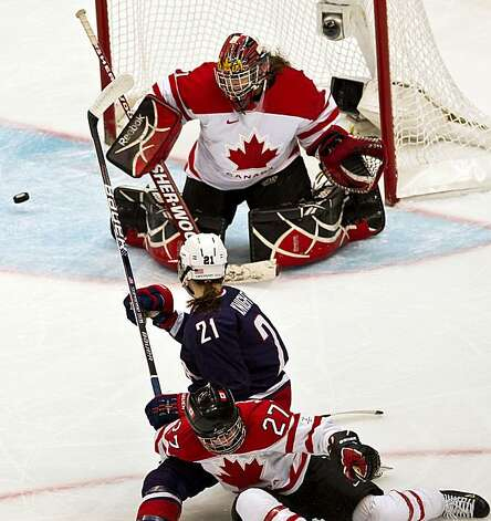 Canada's Shannon Szabados makes a save on a shot by USA's Hilary Knight as Canada's Gina Kingsbury defends during Canada's victory over the USA in the women's gold medal hockey game at the 2010 Winter Olympics on Thursday, Feb. 25, 2010, in Vancouver.  ( Smiley N. Pool / Houston Chronicle) Photo: Smiley N. Pool, Chronicle Olympic Bureau