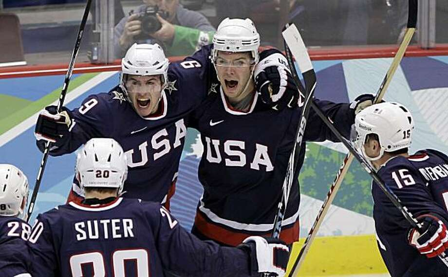 USA's Zach Parise (9) is congratulated by Paul Stastny (26)  and others after Parise scored a goal in the third period of a men's quarterfinal round ice hockey game against Switzerland at the Vancouver 2010 Olympics in Vancouver, British Columbia, Wednesday, Feb. 24, 2010. Photo: Matt Slocum, AP