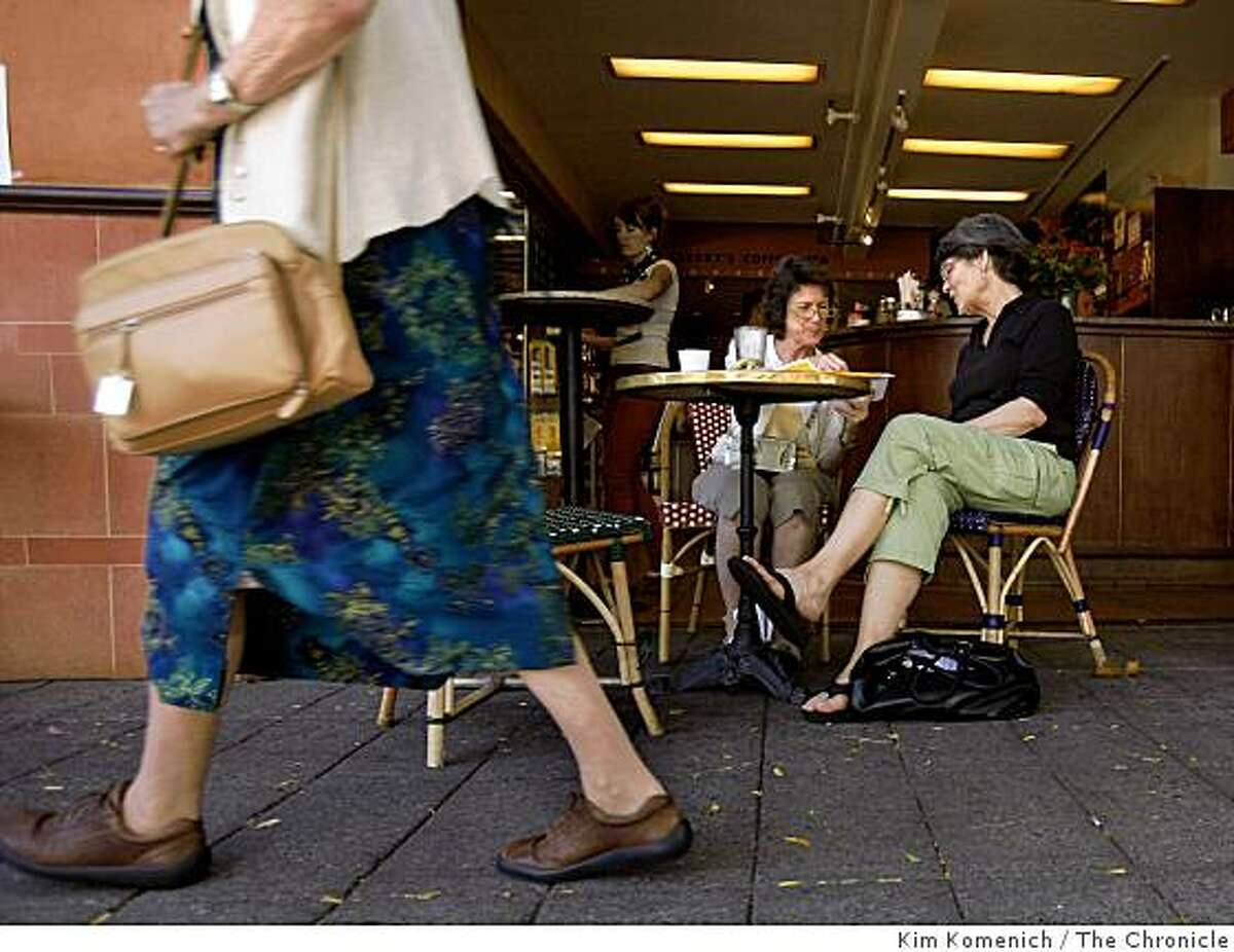Heidi Johnson and Jean Circiello of Oakland meet for a snack at Peaberry's Coffee and Tea on College Avenue in Oakland, Calif's Rockridge district on Wednesday, Aug. 20, 2008. A series of robberies in the area is on the minds of many merchants and patrons.