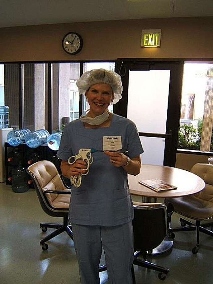 Christina Bernstein, a medical device engineer and independent sales representative from San Francisco, holds a disposable surgical tool that she estimates costs about $40 to make -- but is marked up to about $1,200. Photo: Courtesy Of Christina Bernstein, Christina Bernstein