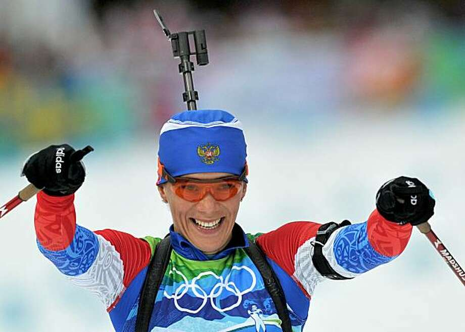 Olga Zaitseva of Russia celebrates after winning gold during the women's Biathlon 4x6km relay at the 2010 Olympic Winter Games at Whistler Olympic Park in Whistler, Canada on February 23, 2010. (Gouhier-Hahn-Nebinger/Abaca Press/MCT) Photo: Gouhier-Hahn-Nebinger, MCT