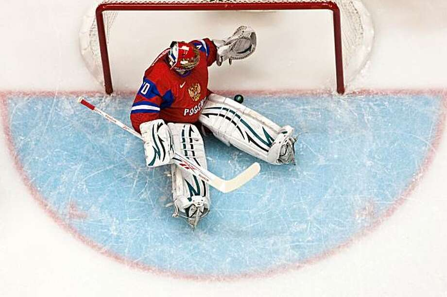 Russia's Evgeny Nabokov sits in the crease after giving up a first period goal against Canada in men's hockey quarterfinal action at the 2010 Winter Olympics on Wednesday, Feb. 24, 2010, in Vancouver.  ( Smiley N. Pool / Houston Chronicle) Photo: Smiley N. Pool, Chronicle Olympic Bureau