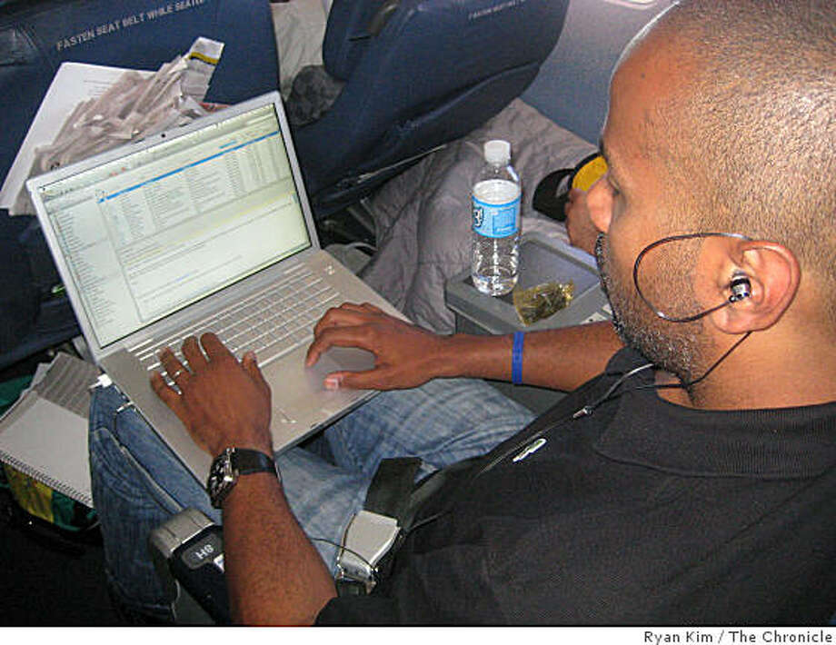 Ty Ahmad-Taylor, 40, of New York catches up on e-mail while flying from New York to Los Angeles. Photo: Ryan Kim, The Chronicle