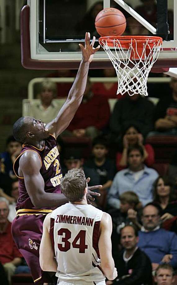 Arizona State center Eric Boateng (2) scores past Stanford forward Andrew Zimmermann (34) in the first half of an NCAA college basketball game in Stanford, Calif., Thursday, Feb. 25, 2010. Photo: Paul Sakuma, AP